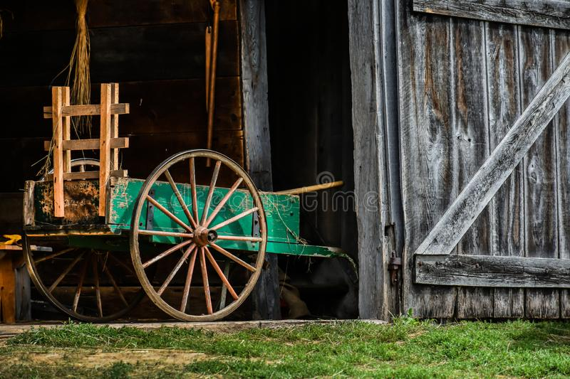 Wooden Barn with a Carriage royalty free stock images