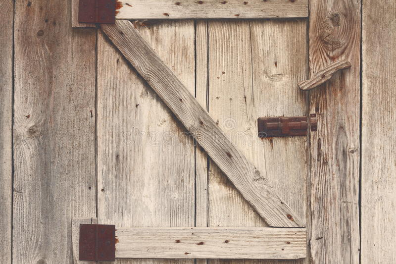 Wooden barn door detail. Textured view with vintage effect royalty free stock photos