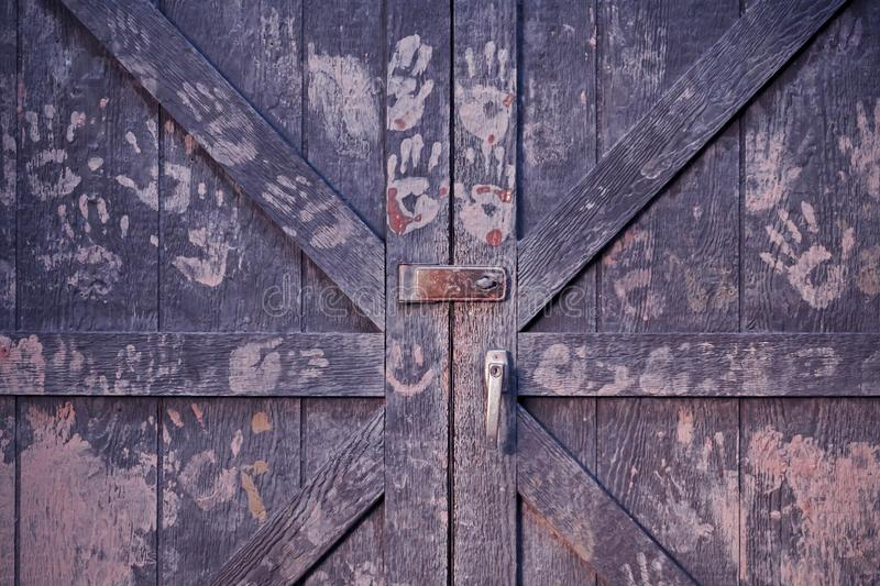 Wooden barn doors with handprints. Background stock photography