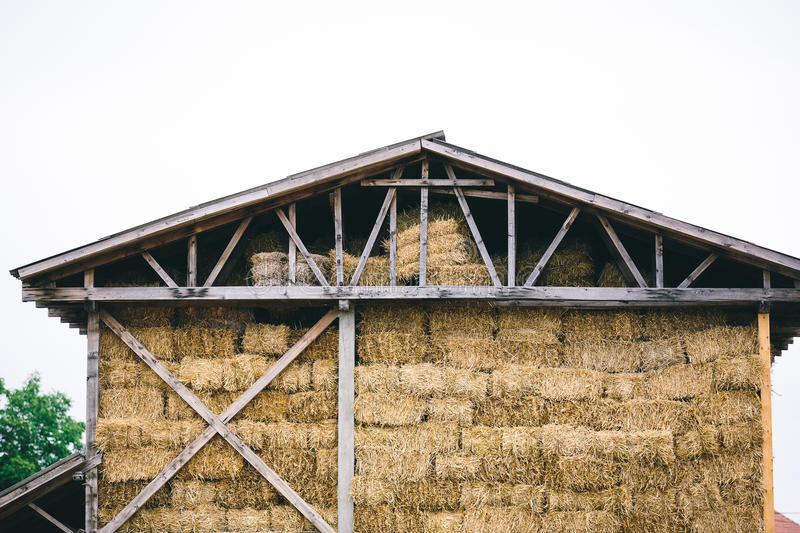 Wooden barn. Hay stacks in old wooden barn royalty free stock photos