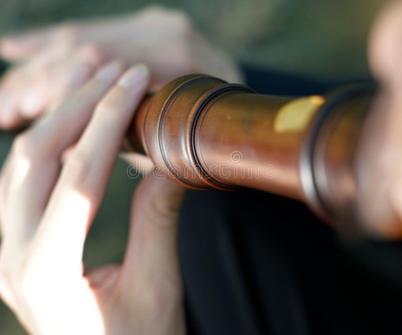 Baroque recorder. Wooden baroque recorder being played royalty free stock photos