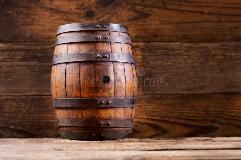 Wooden barrel on wooden background stock photo