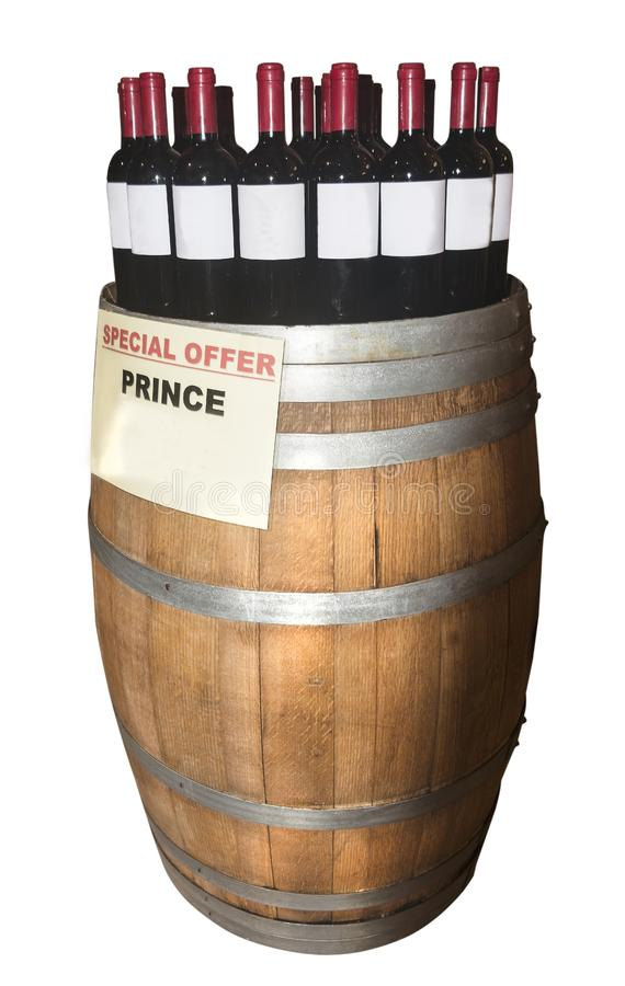 Wooden barrel with bottles of wine. Isolated on the white background royalty free stock photo