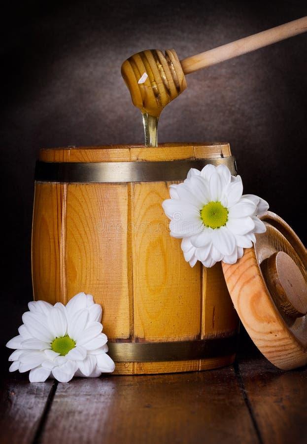 Wooden barrel of honey stock photo