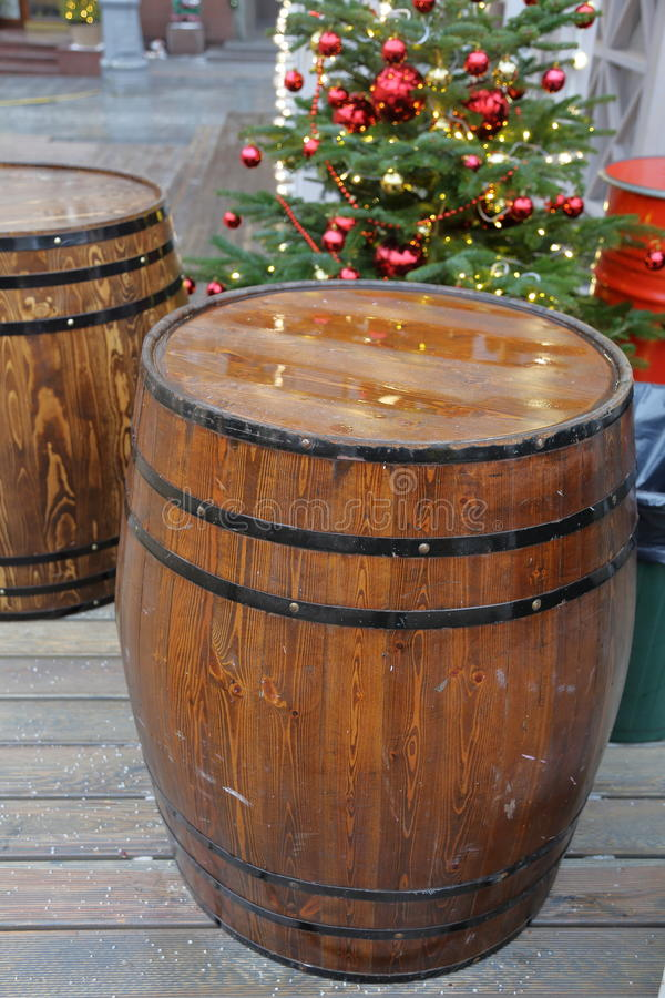 Wooden barrel with hoops. A large barrel of oak with black hoops royalty free stock image