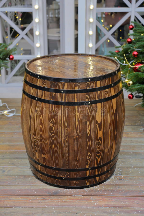 Wooden barrel with hoops. A large barrel of oak with black hoops stock images