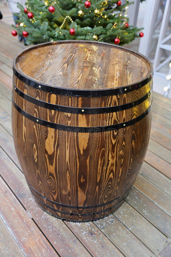 Wooden barrel with hoops. A large barrel of oak with black hoops royalty free stock photo