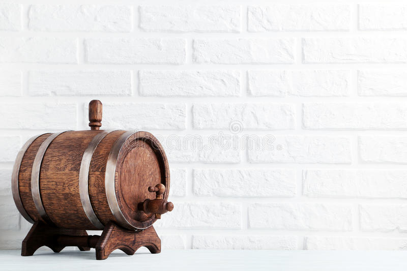 Wooden barrel. With iron rings on brick wall background royalty free stock images