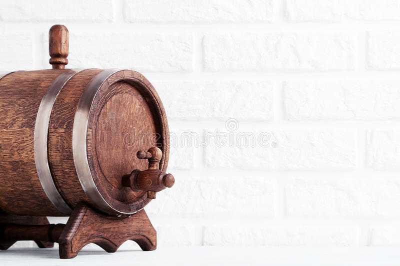 Wooden barrel. With iron rings on brick wall background royalty free stock photography