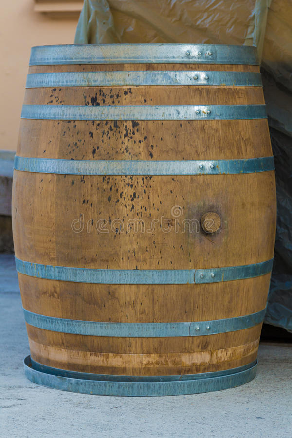 Wooden barrel. Large wooden barrel as bar table with a hole to drain in the middle royalty free stock image