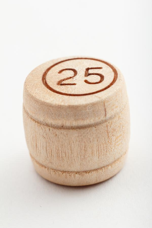 Wooden barrel number for a lotto game on a white background. Close-up view royalty free stock photo