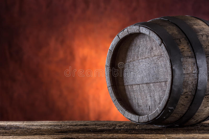 Wooden barrel. Old wooden keg. Barel on beer vine whiskey brandy or cognac royalty free stock image