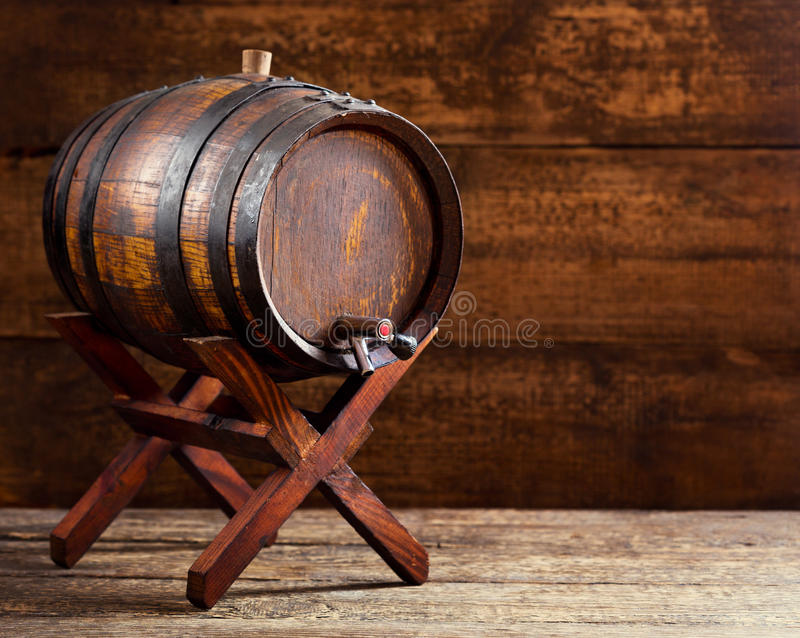 Wooden barrel on rustic wooden background stock photography