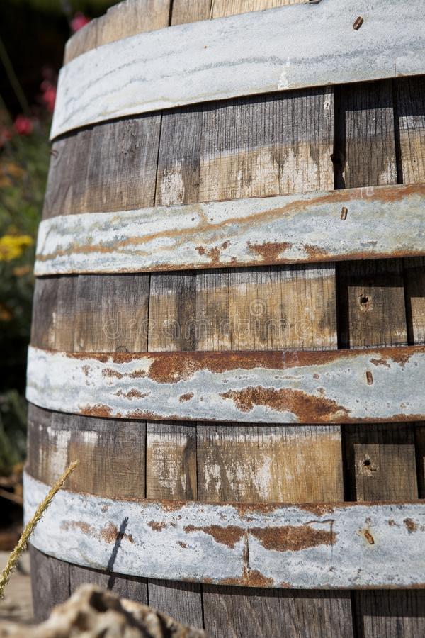 Wooden barrel with some rust stock image
