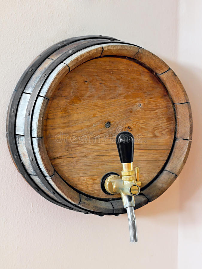 Wooden barrel with a tap stock photos
