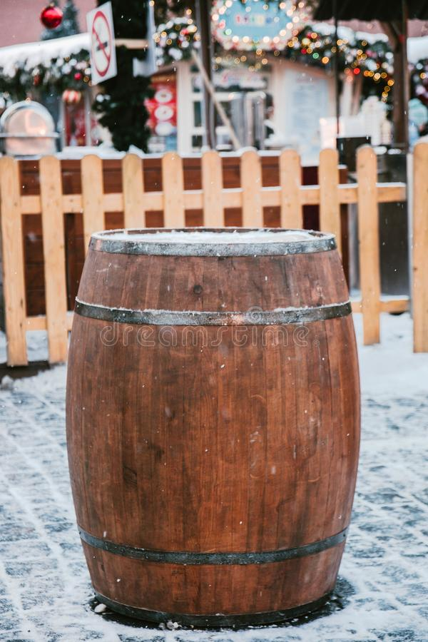 Wooden barrel used as a table on the background of a wooden fence and Christmas decorations.  stock photos