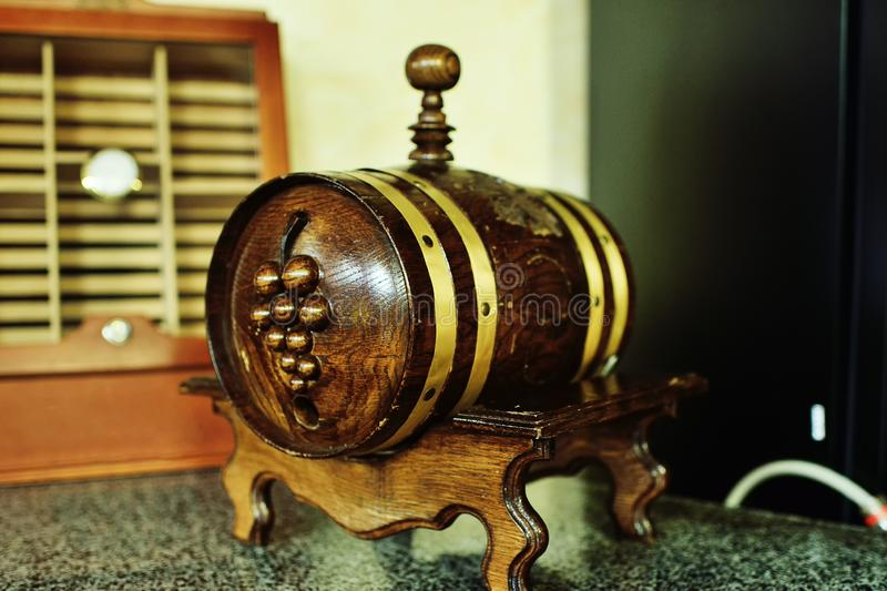 Wooden barrel with wine with a picture of grapes. Close up royalty free stock photography