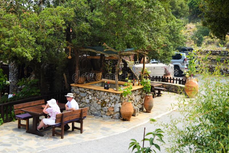 Crete, Greece - June 22, 2015: Wooden barrel of wine and table in outdoor cafe. Street cafes in Crete, Greece. Crete, Greece - June 22, 2015: Wooden barrel with royalty free stock photography