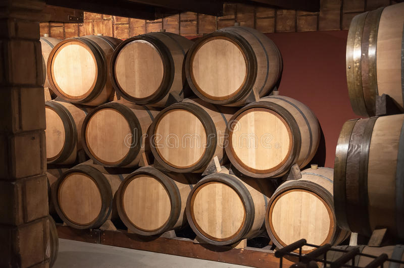 Wooden barrels in the cellar stock image