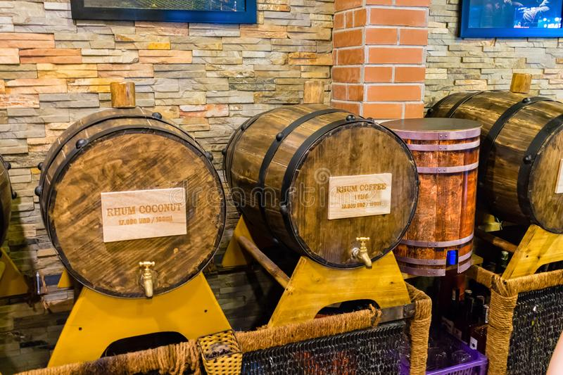 Wooden barrels with metal tap with alcohol inside with a brick wall stock photos