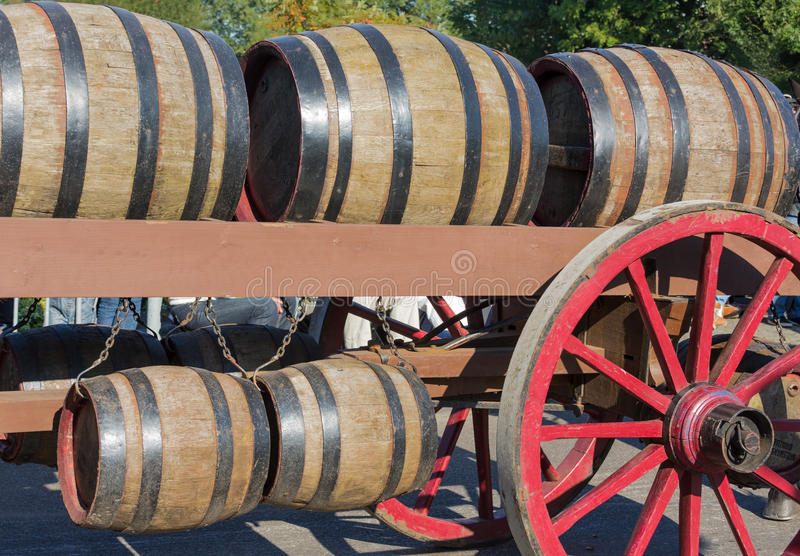 Wooden barrels at an old farm wagon in a countryside parade royalty free stock photos