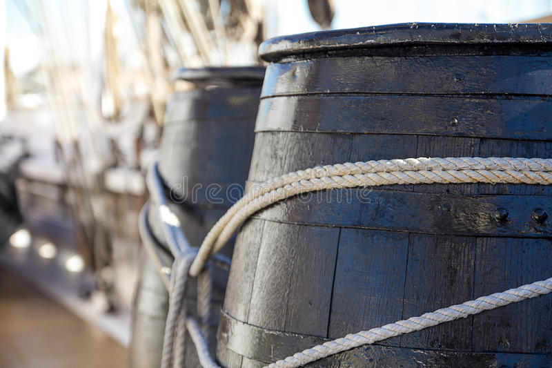 Wooden barrels in a ship. Outdoor shot of old-fashined barrels in a passenger ship stock image