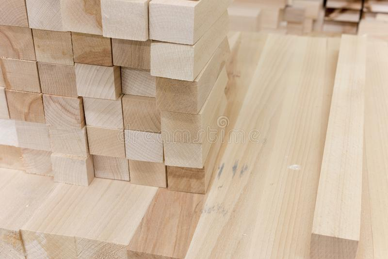 Wooden bars in the production in the carpentry shop for furniture. Wooden bars in the carpentry shop for furniture production stock image