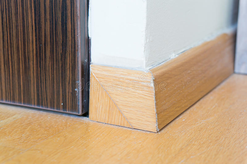 Wooden baseboard. On corner stock photography