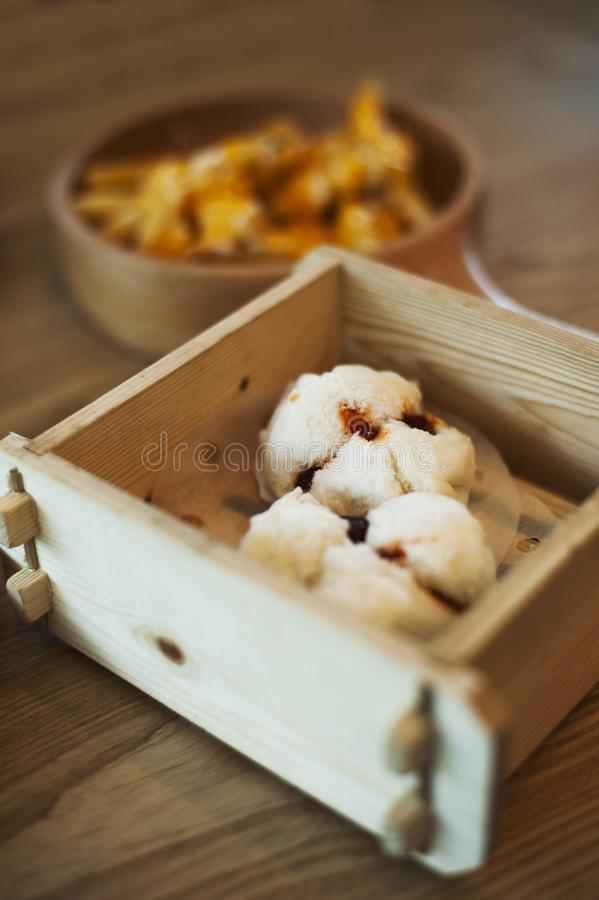 A wooden basket holding two delicious BBQ pork buns stock photo