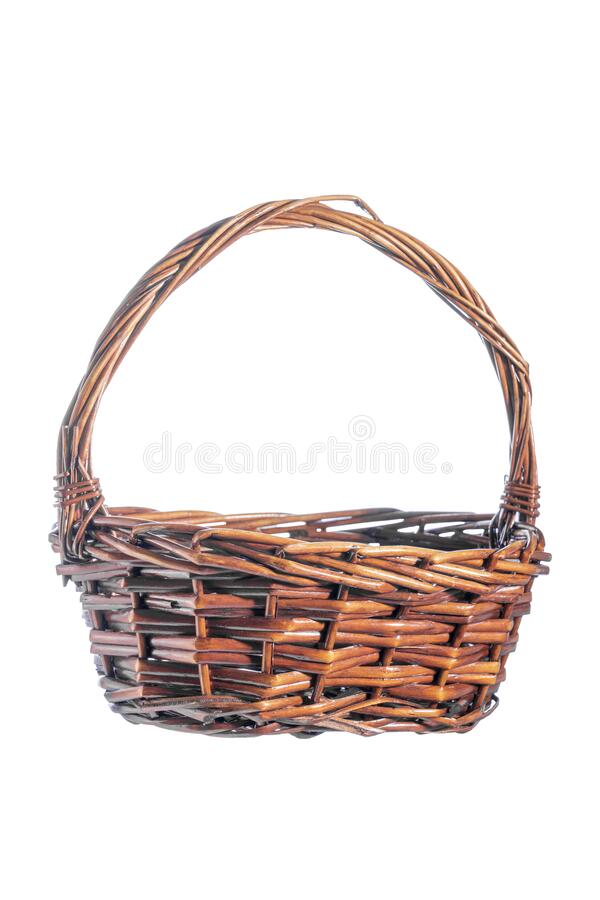 Wooden basket isolated on white background. Close-up, empty for your products, blank for design, selective focus stock image