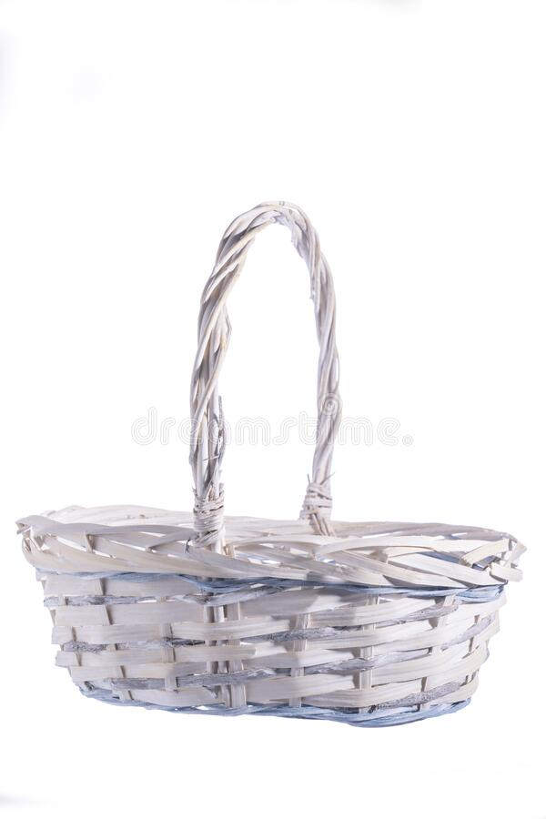 Wooden basket isolated on white background. Close-up, empty for your products, blank for design, selective focus stock photography