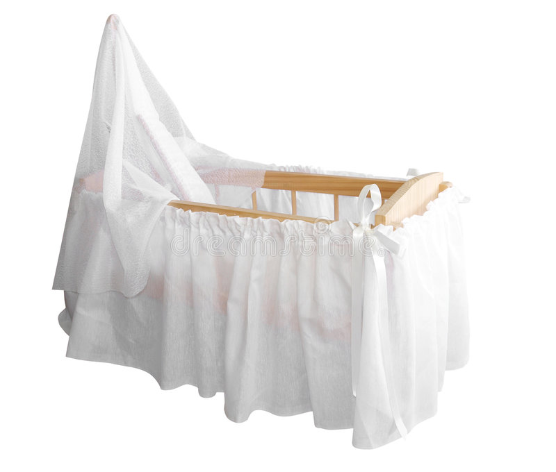 Wooden Bassinet with White Drapes. Isolated with clipping path royalty free stock image