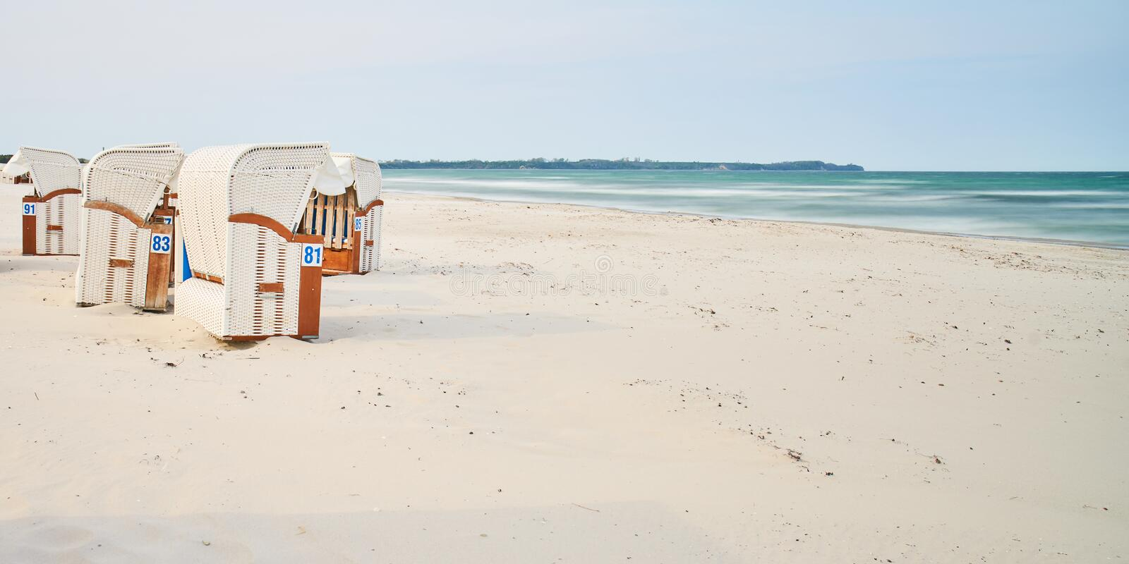 Wooden beach chairs, Rugen Island, Germany royalty free stock photos