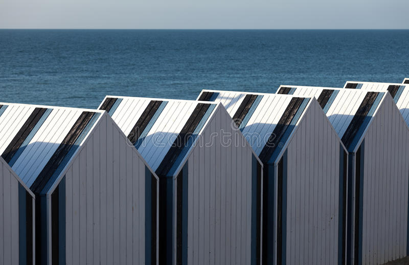 Wooden beach chalets stock images