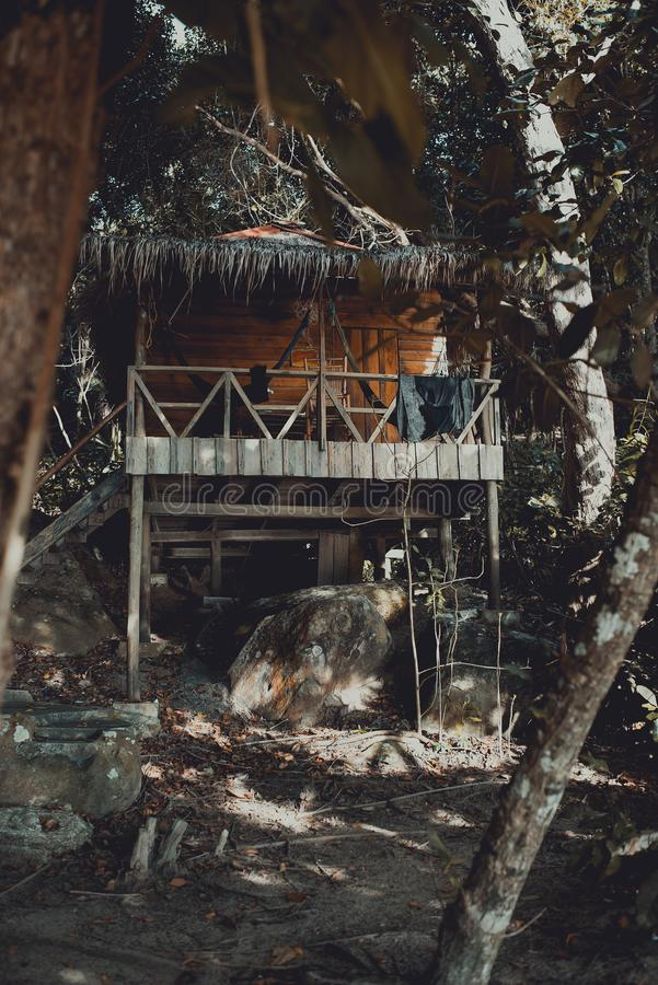 Wooden beach hut between trees in the jungle. Koh Rong Samloem Island, Sunset Beach. Cambodia royalty free stock photography