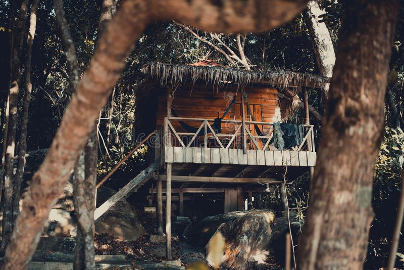 Wooden beach hut between trees in the jungle. Koh Rong Samloem Island, Sunset Beach. Cambodia stock photography