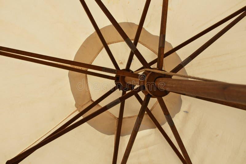 Wooden beach umbrella close-up bottom angle royalty free stock photography