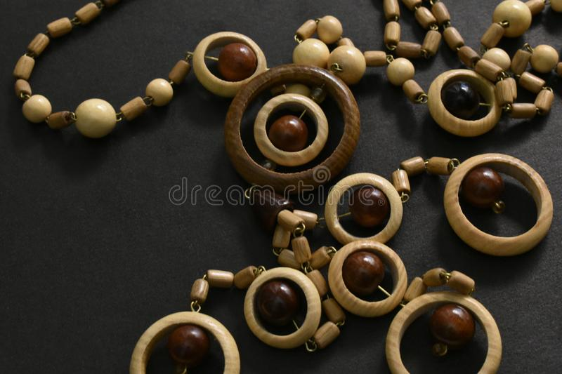 Wooden beads on black background. stock image