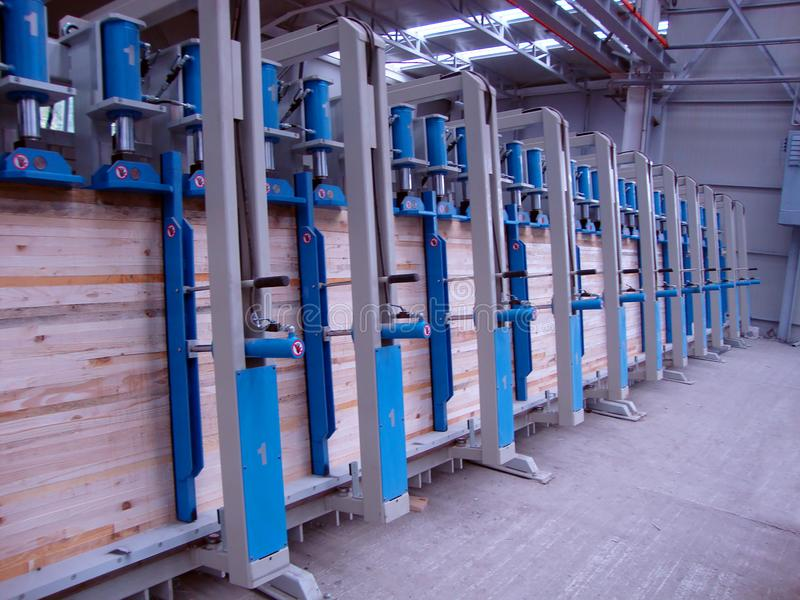 Wood beam press for gluing stock image