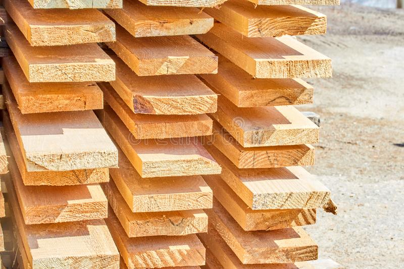 Wooden beams with a clear tree structure. Environmental friendliness convenience durability construction lumber material strength fire resistance sale nature royalty free stock photos