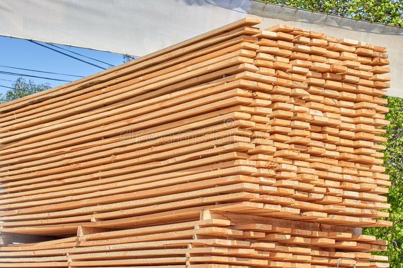 Wooden beams with a clear tree structure. Environmental friendliness convenience durability construction lumber material strength fire resistance sale nature royalty free stock photo
