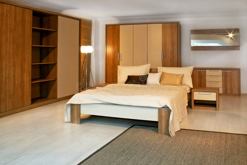 Wooden bedroom 3. Standard bedroom in apartment with wooden furniture royalty free stock image