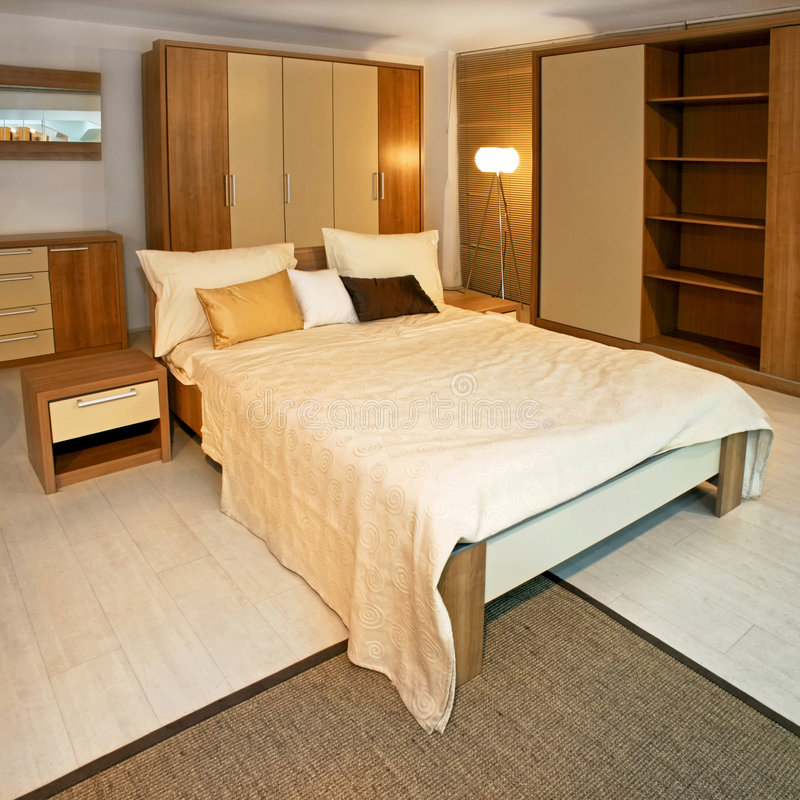 Wooden bedroom angle. Standard bedroom in apartment with wooden furniture stock photography