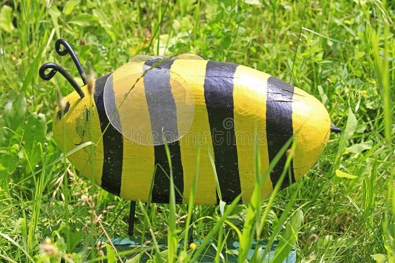 Wooden bee. A wooden bee on a greed meadow royalty free stock photo