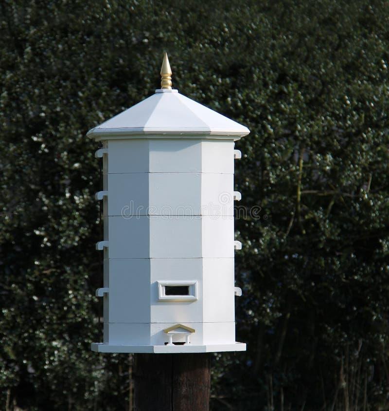 Wooden Bee Hive. An Octagonal Wooden Stewarton Design Bee Hive stock image