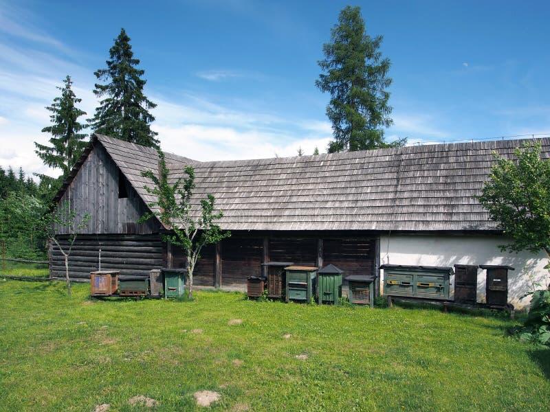 Wooden bee hives near folk house in Pribylina stock photos