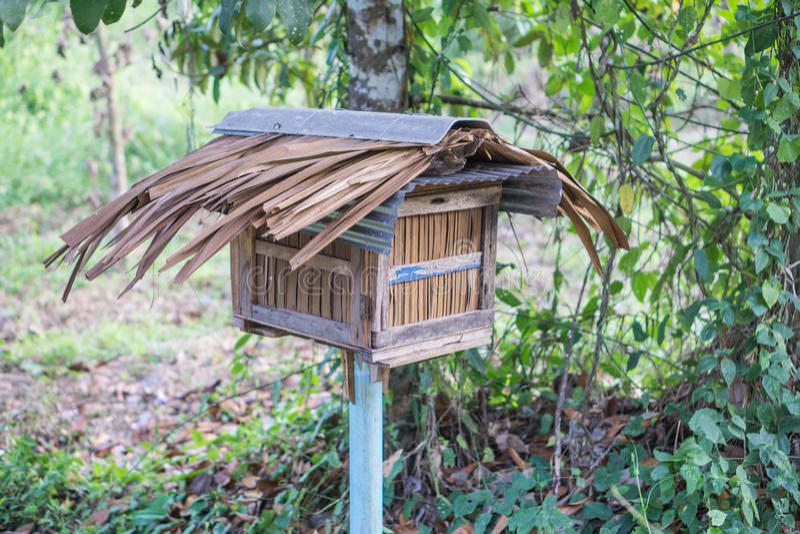 Wooden bee house in the garden. Wooden homemade bee house in the garden royalty free stock images