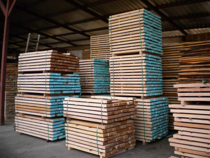 Wooden beech boards. Sawmill in Serbia with huge stock beech boards.Peaceful environment for success.Place for hard work. Work place for real enthusiastic stock photo