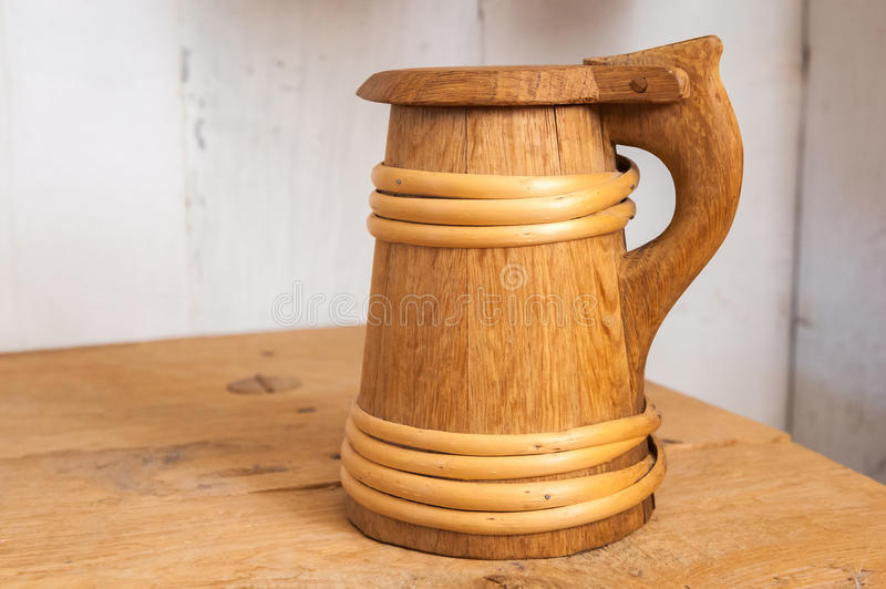 Wooden beer mug. Ancient wooden beer mug on a table stock photos