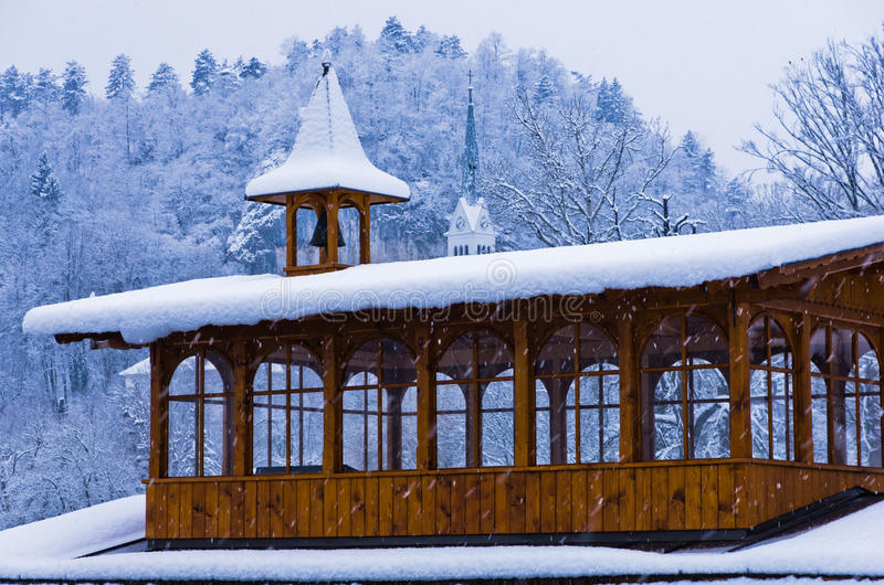 Wooden bell tower in a heavy snow near the lake Bled in slovenian alps royalty free stock images